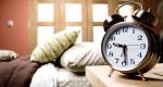 Alarm clock on nightstand in bedroom